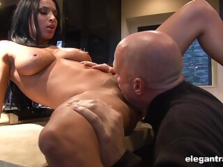 Aroused beauty handles the big stick in imposing modes